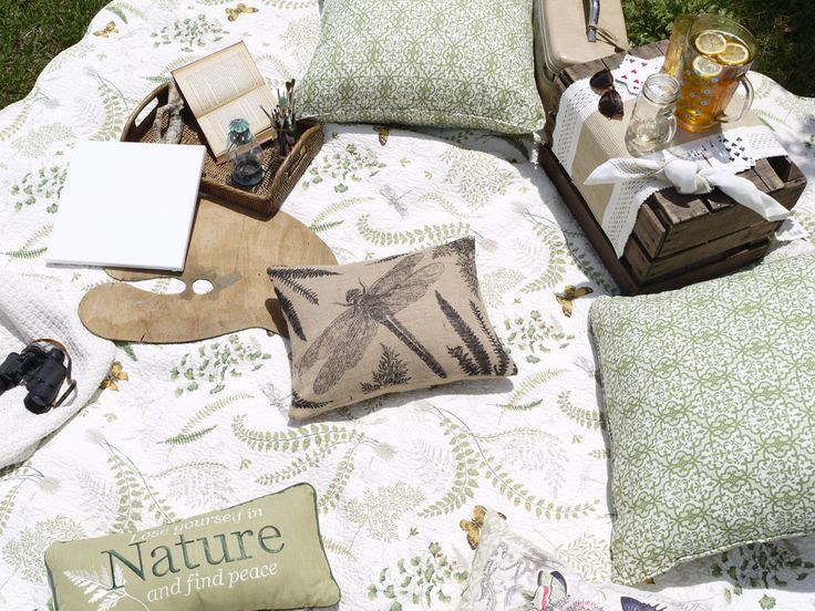 "Picnic accessories featuring C&F's ""Althea"" Quilted bedding collection and coordinating throw pillows."
