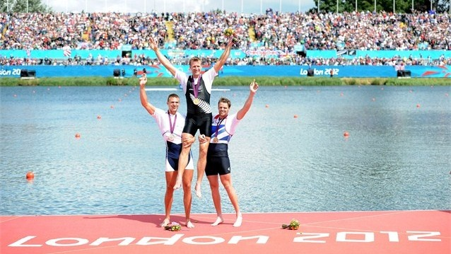 Gold medalist Mahe Drysdale of New Zealand is lifted on the shoulders of silver medalist Ondrej Synek (L) of Czech Republic and bronze medalist Alan Campbell (R) of Great Britain during the medal ceremony for the Men's Single Sculls final on Day 7
