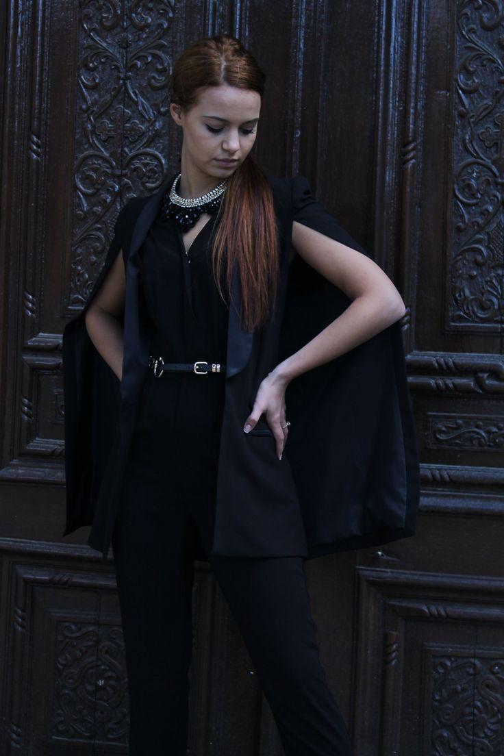 Black women cape and black jumpsuit. http://www.womanfashion.ro/jachete-online/jacheta-neagra-stil-capa-4081  http://www.womanfashion.ro/salopete-online/salopeta-neagra-cu-curea-in-talie-si-spatele-decupat-4242
