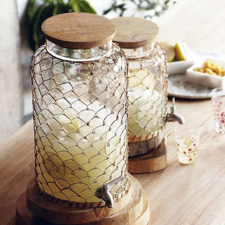"""b1 availablebbrbrGlass beverage dispensers are finely dressed in delicate woven rattan sleeves. Each has a mango wood top and a stainless steel spigot.brbrliDimensions: 9""""dia x 16.5""""h, ..."""