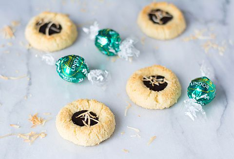 Crisp shortbread with coconut and a heart of rich chocolate ganache. True bliss.