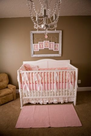 I LOVE little chandeliers in baby rooms. So precious! And the Picture