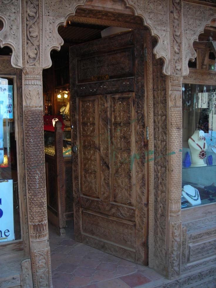 Handcarved wooden door displayed at lok virsa mela for Wood doors in pakistan