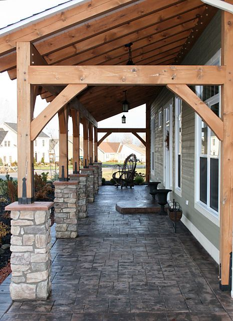 timber frame porch with rock stacks