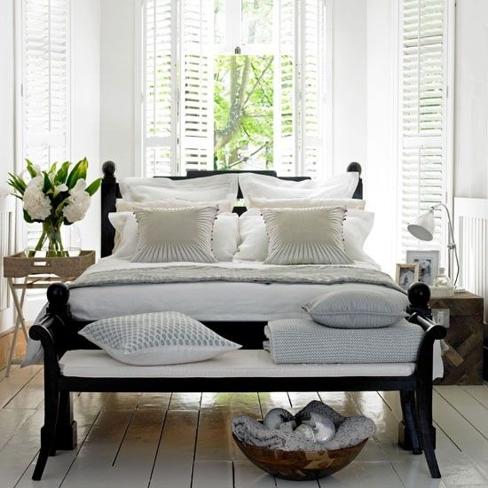 a white bed with a comfy bench at the end....I love it