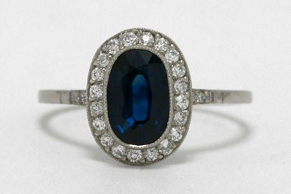 Antique sapphire 1.52 carat platinum engagement ring surrounded by 0.30 carats of diamonds in the halo. See this beautiful design at Bella Rosa Galleries in Santa Barbara, CA, or on the web.
