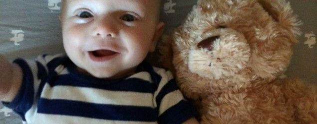 Baby meets a likely lifelong friend — a teddy bear. (ABC News)