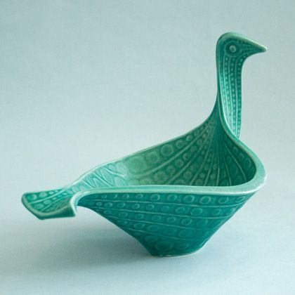Jade Bird Bowl - Jonathan Adler: I love the clean lines, the color and the play of light and shadows of this graceful bowl.