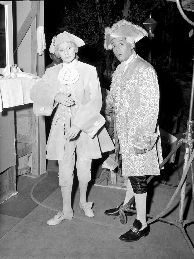 "Lucille and Desi take a photo backstage in their costume's for the episode ""The Ricardos Dedicate a Statue."" This also happened to be the final episode of the series."