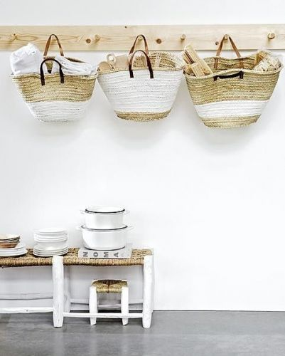 Woven baskets on hooks used as storage. An easy way to free up a little floor space.