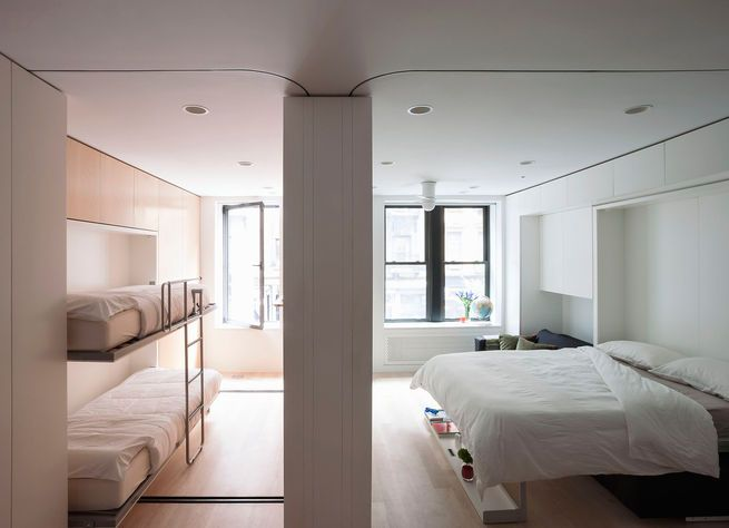 This conceptapartment presented by LifeEdited in SoHoshows how much one can fit in 420squarefeet. Murphy beds make it possible to sleep four. When they're not in use, a large dining table can be pulled out.  Photo by: Matthew Williams