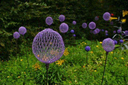 These spheres are made with nothing more than chicken wire and spray paint.    I think the effect is great and a quick respray from time to time would let them move with the seasons or garden make over.