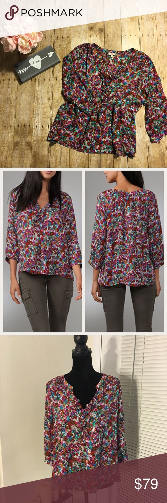 Joie Magpie Floral Calabasas Silk Blouse Joie Magpie Floral Calabasas blouse. Bright watercolor pattern. 3/4 sleeves with double button closure at the cuff. Slim ruffle frames the v-neck. Three button closure at the neckline. Joie Tops Blouses