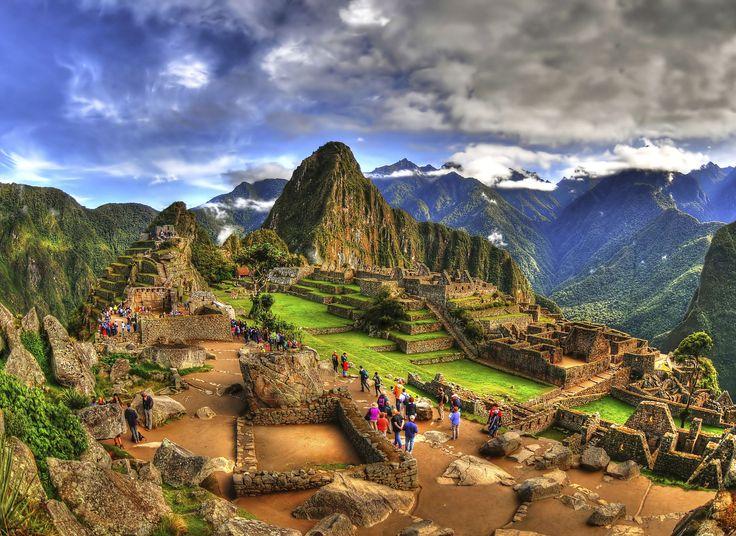 Machu Picchu Machu Picchu, Peru mountain sky Nature outdoor mountainous landforms canyon valley geographical feature mountain range landmark landscape aerial photography plateau alps terrain panorama Village hillside
