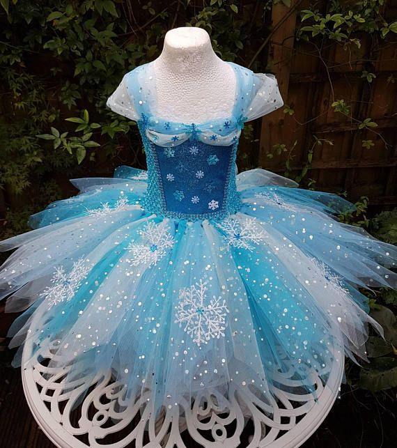 Welcome to my shop. My Snow Queen inspired tutu dress is my take on the very popular Frozen character. The dress is made up of 3 layers of plain and sparkly turquoise, blue and light turquoise tulle. The skirt is cut into point edges known as pixie cut and decorated with snowflakes. The