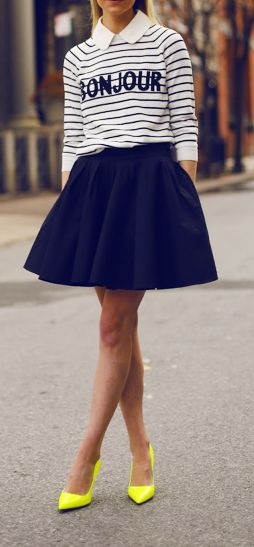 A thing striped black and white half sleeve shirt with this skirt, a hat, tights, and a pair of black small boots.