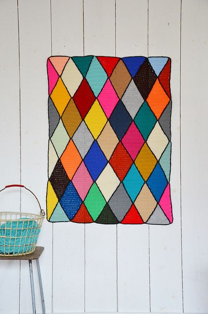 Wood and Wool Stool turns a Harlequin #Crochet Blanket into colorful wall #art