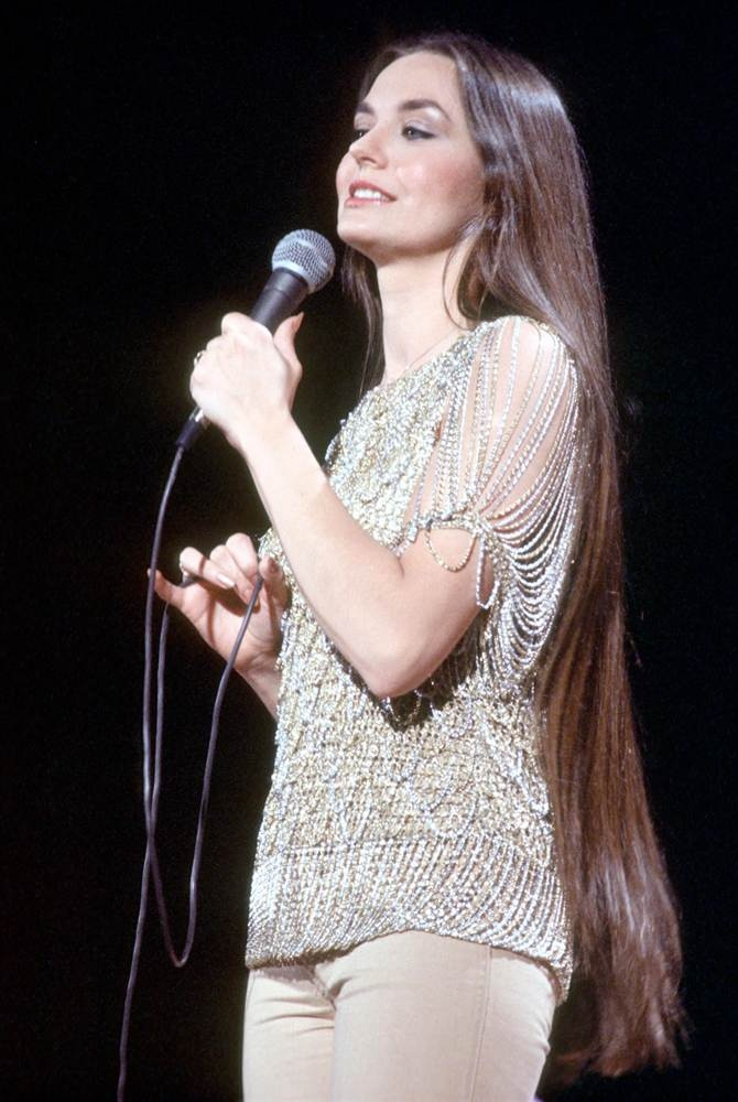 """Crystal Gayle (born Brenda Gail Webb on January 9, 1951) Award-winning American country music singer. She accumulated 20 No. 1 country hits during the 1970's & 1980's  with 6 albums certified Gold by the RIAA. 1st female artist in country music history to reach Platinum sales with her 1977 album, """"We Must Believe in Magic"""". Voted one of the 50 most beautiful people in the world by People Magazine,1983. The younger sister (by 19 yrs) of Loretta Lynn, & distant cousin of singer Patty Loveless."""