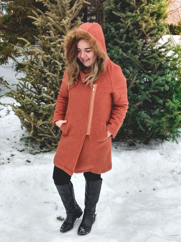 Salmon-pink OAZQ coat with black denim and boots.