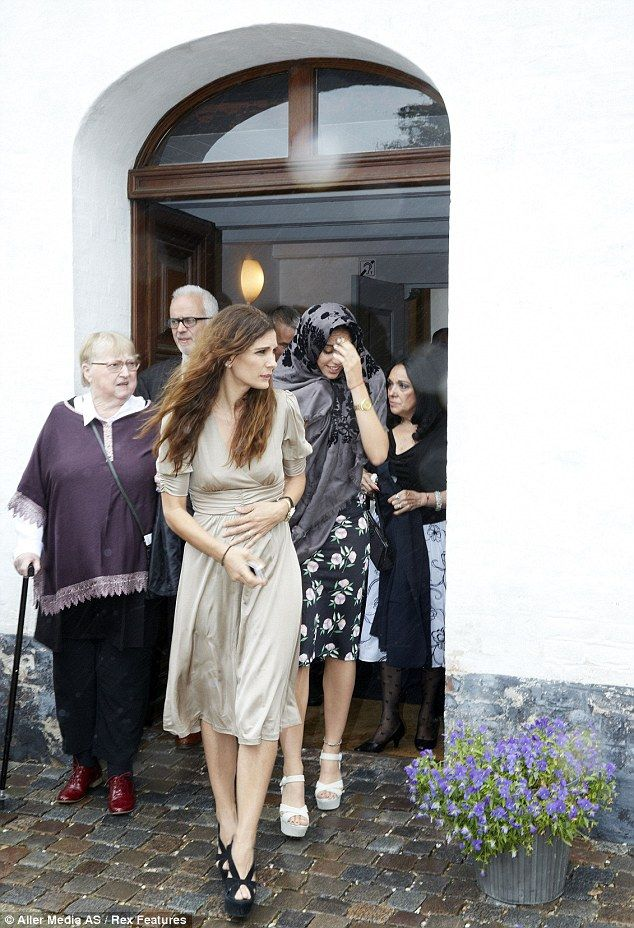 Daddy's girl: Lourdes Leon (in floral black) attended her father Carlos' recent wedding to Betina Holte in Gillelje, Denmark