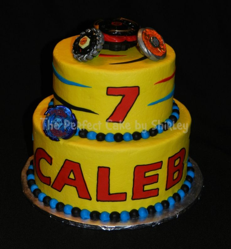 Kyan wants this cake, of all the beyblad cakes he chose the easiest one :D - Simple Beyblade cake. Iced in buttercream, fondant decorations, real Beyblades. Thanks to kimmy37 for the inspiration!