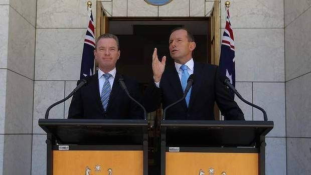 Education Minister Christopher Pyne and Prime Minister Tony Abbott address the media at Parliament House. Picture: Alex Ellinghausen