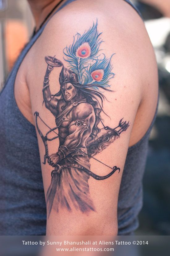 Warrior Lord Krishna Tattoo by Sunny Bhanushali at Aliens Tattoo, Mumbai. Client was looking for Lord Krishna tattoo for his arm, he wanted Lord Krishna in strong, aggressive, warrior like appearance. We used the very famous character of Dashavatar(Lord Vishnu), which is the main cover image of Vimanika Comics.(http://www.vimanika.com/). I added peacock feathers as a background, so it looks like Lord krishna as the original image was of Lord Vishnu. Client was very happy with this lord…