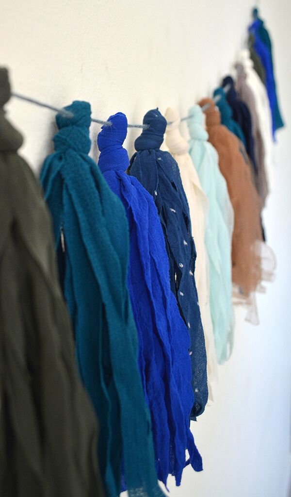 Make a fun tassel garland out of old nylons or tights. // Laura from Lovely Wren on Dream A Little Bigger Blog