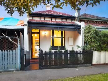 Photo of a rendered brick house exterior from real Australian home - House Facade photo 525233Linking: white/light render, red roof, navy/grey trim..
