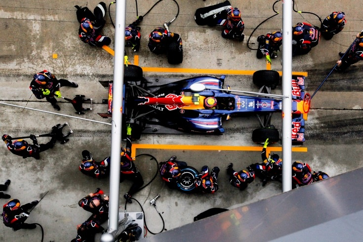 March 25, 2012. Australian Formula One racer Mark Webber, of Red Bull Racing, arrives at a pitstop during the 2012 Formula One Grand Prix of Malaysia at the Sepang International circuit, outside Kuala Lumpur.