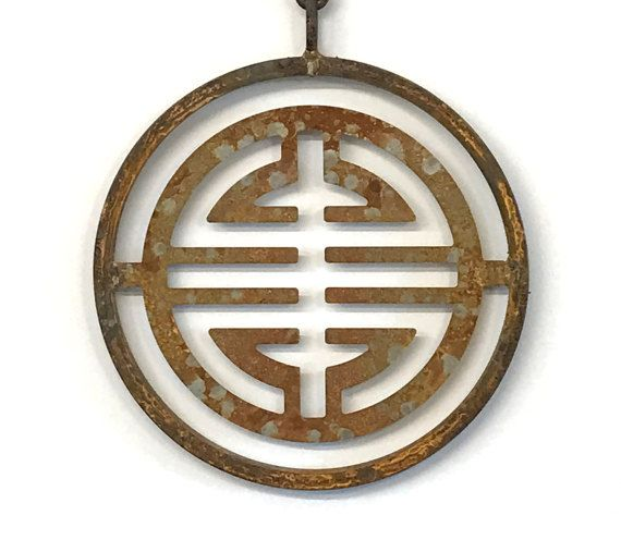 Tibetan Symbol Pendant 11.5 X 11.5 plus a 5 chain and ring The character represented in this elegant garden sculpture is an ancient Tibetan symbol meaning LONG LIFE, which promotes well being by enhancing the possibility for a healthy, long, and fulfilling life. This piece is individually handmade of durable solid steel, it comes with a ring attached to the top of the chain (3 links). This piece can hang anywhere. Ive seen customers add this to the eaves of a porch, put on a hook, a fence…