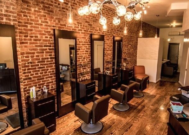 Idalias salon ny wood trim exposed brick and accent walls for Salon pictures for wall