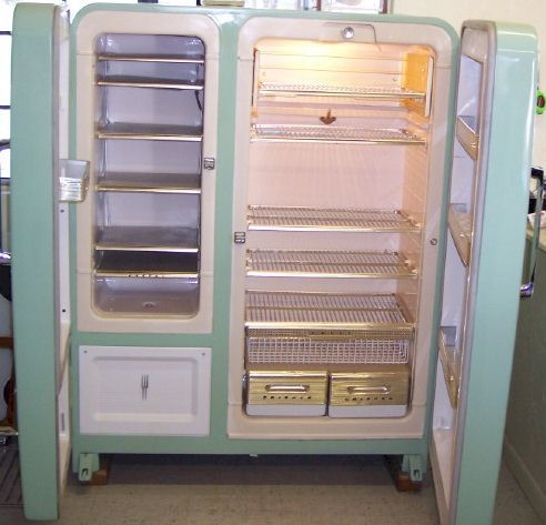 Amazing vintage light green refrigerator.. with side by side doors. And completely renovated. It is perfect! This is the interior..