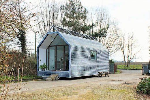This tiny home was designed by Thomas Alabaster of Contemporary Shepherd Huts based in Suffolk, England. It was inspired by the actual huts shepherds in the area used to live in long ago while taking their animals to pasture. His creation features a skylight, which brings in lots of light, while the whole home appears cozy and welcoming, despite being small. The tiny home is mounted on wheels making it mobile, though the exact dimensions…