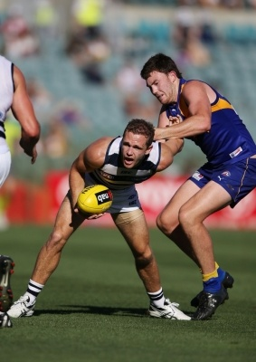 Typical, Joel getting chicken winged, NAB Cup Geelong Cats v West Coast Eagles, round 1 - Photo Gallery | Geelong Advertiser | geelongadvertiser.com.au