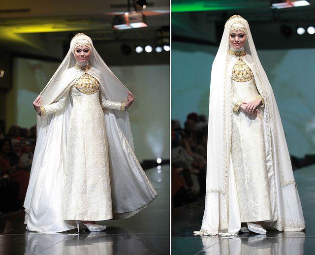 bride in muslimah wear. credits: dian pelangi