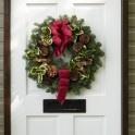 Festive door wreath send flowers