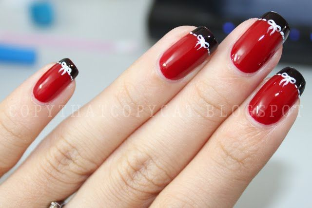 Red nails with black tips and white bows. Description from pinterest.com. I searched for this on bing.com/images