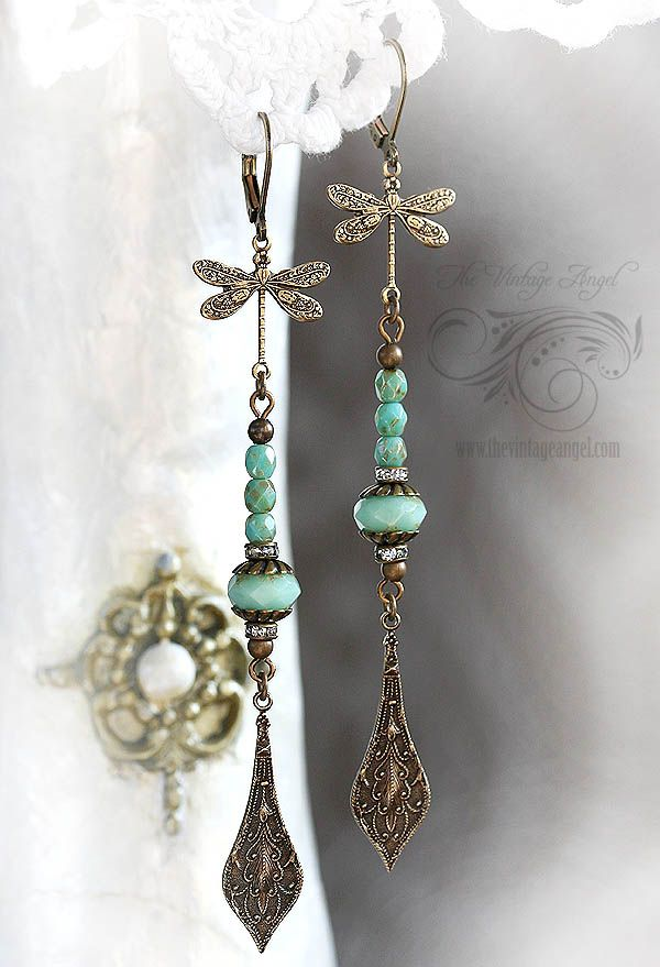 Extra long, delicate and so vibrant...this pair of earrings is a fantasy to behold. Victorian style dragonflies in antiqued brass suspend an assembly of Czech glass rounds and vintage rondelles in fresh mint green hues. Finished with elaborate Victorian style pendants in aged brass. Hung on leverback hooks for pierced ears. All metal is antiqued brass, free and lead and nickel. Lightweight and easy to wear despite their length, includes earring backs. Comes be