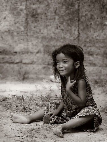 there is something indefinable in her face, girl, child, kid, hands, expression, hands, beauty, cute, powerful face, intense eyes, emotional, poverty, portrait, b/w