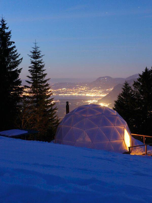 Thats my kind of camping! With beds and fireplaces inside each of the 15 igloo-shaped pods. The WhitePod Alpine Ski Resort, The Swiss Alps, Switzerland.