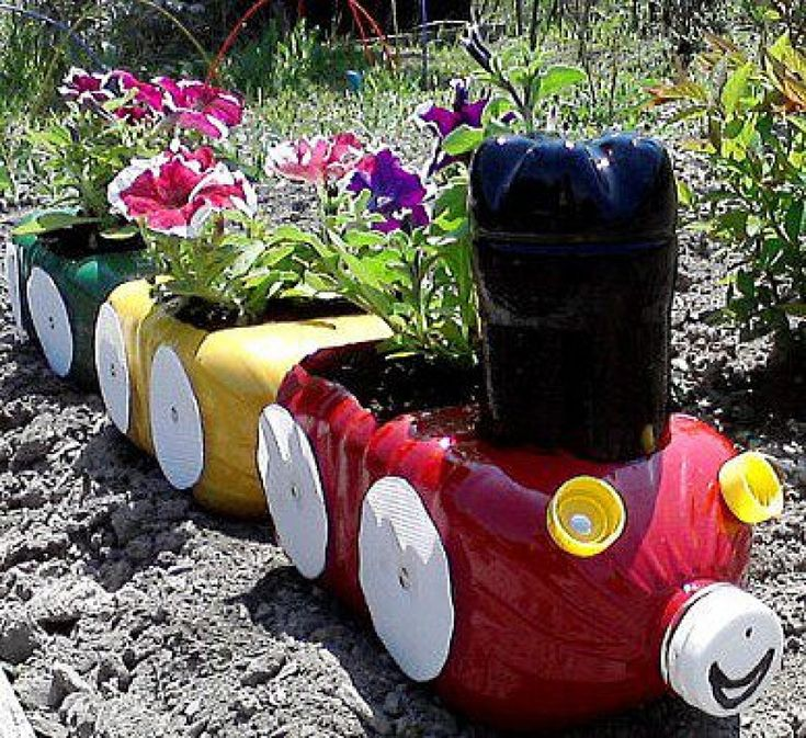 a flower bed of plastic bottles