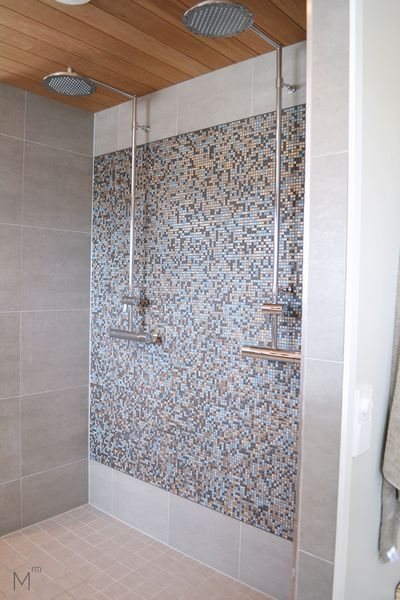 Scandinavian bathroom with two showers, mosaic tiles and warm colors. Interior design by Marika Ritala-Mäkinen (Tampere, Finland)  #scandinavian #bathroom #mosaic #tiles #warm #colors #showers #greytiles