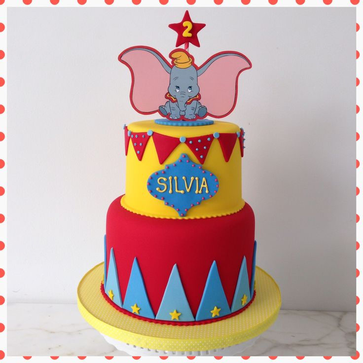 Dumbo birthday: cake, circus, red, yellow, blue, pennants, elephant