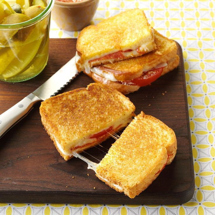 Pizza Sandwiches Recipe -Mary Monaco of Columbus, Ohio gives grilled cheese a special treatment by using slices of mozzarella cheese and adding delicious extras like pepperoni and fresh tomatoes. Dipped in warm pizza sauce, each one will be a fast favorite!