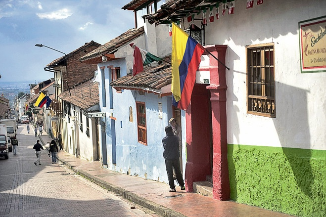 Visit the historic La Candelaria neighborhood and see graffiti murals and houses with terracotta roofs.