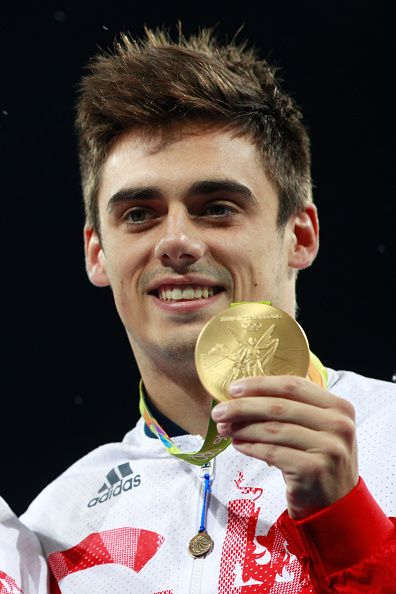 #RIO2016 Gold medalist Chris Mears of Great Britain poses during the medal ceremony for the Men's Diving Synchronised 3m Springboard Final on Day 5 of the Rio...