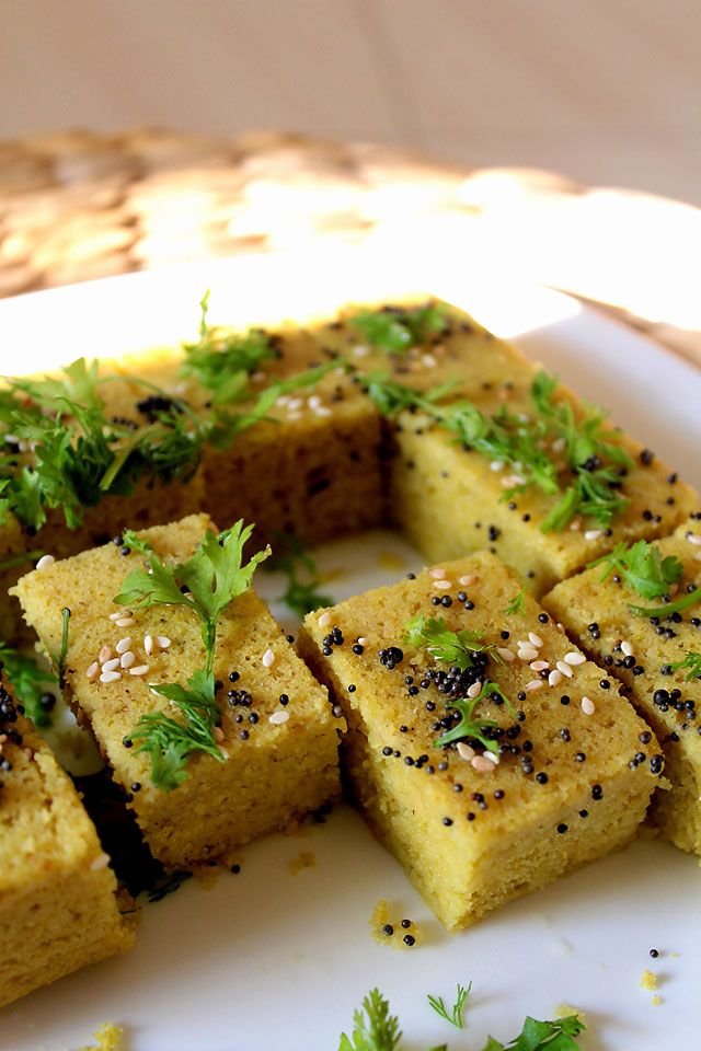 khaman dhokla is a savory steamed cake made from gram flour or chana dal (skinned spilt bengal gram). khaman dhokla are soft, porous, mildly tangy-sweet and a great snack anytime of the day.