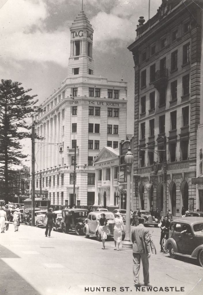 Hunter Street East showing the T and G Building. Pine tree are in front of the Police Station. This image was scanned from a photograph in the Newcastle and Hunter District Historical Society archives which are held by Cultural Collections at the University of Newcastle, Australia. If you have any information about this photograph, please contact us. Please contact us if you are the subject of the image, or know the subject of the image, and have cultural or other reservations about the…