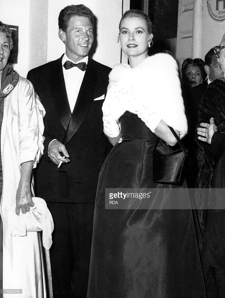 French actor Jean Pierre Aumont with Grace Kelly at the International Cannes Film Festival, 6th May 1955.